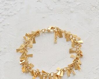 Nina Bracelet in Gold, metal charm bracelet