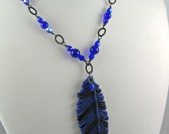 Blue Jay feather necklace, polymer clay pendant on beaded matte black chain