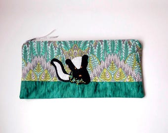 """Zipper Pouch, 4.75x10"""" in Lime, White, Teal, Aqua, Black, Green and Gray Feather Print Fabric with Handmade Felt Skunk, Skunk Pencil Case"""
