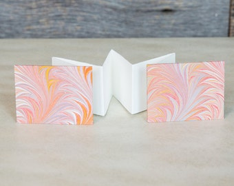 Tiny accordion book with marbled, handmade paper cover