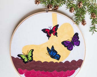 Hand embroidered butterflies in the stomach