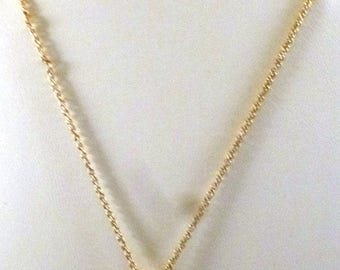 Vintage Gold Tone Pendant Necklace with Rhinestones and White Cabochon Center, 1980s