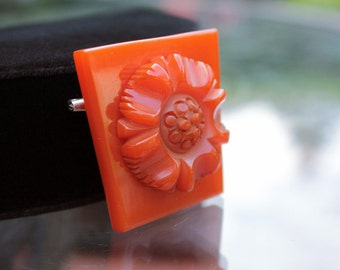 Heavily Carved Bakelite Flower Brooch in Pumpkin Orange