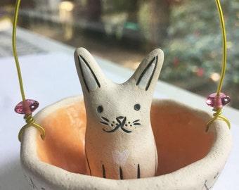 Cute Little Bunny Sitting in a Basket Ceramic Sculpture