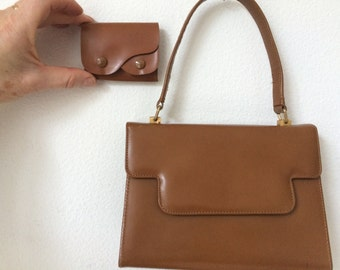 Vintage stylish brown leather Delco handbag with matching little purse