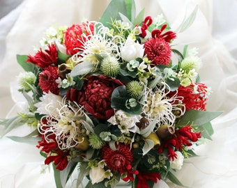 Red and white Australian native rustic bouquet.  Wedding bouquet of native flowers.  Banksia, waratah, grevillia , waxflower and more.