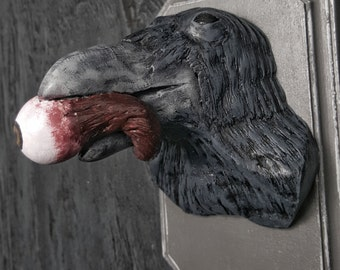 The Blackest Of Ravens With Severed Eyeball Wall Plaque