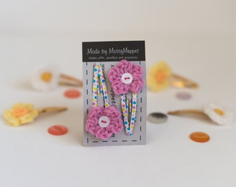 Pink Crochet Flower Clips with white button middles and spotty snap clips