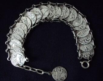 "Bracelet, silvercoins,  Zodiac design, reverse to constellations, size 7.25 "" c. 1940's"