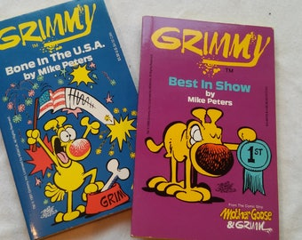 """Pair of Vintage Early 90's Grimmy Paperbacks, """"Best In Show"""" and """"Bone In The U.S.A."""" by Mike Peters."""