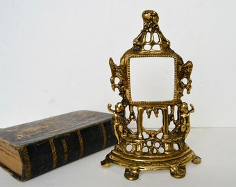 Brass frame with little angels
