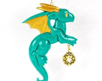 Cute dragon ornament holding a dangling charm, whimsical Christmas tree ornament, handmade resin ornament, multiple colors, gifts for geeks