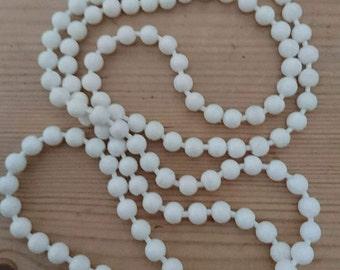 Vintage white popper beads