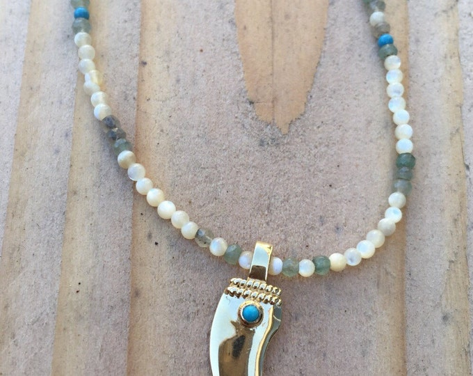 long necklace with a pendant in the shape of Horn and beads in semi precious