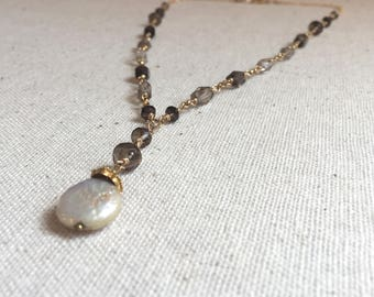 Gold statement necklace with smokey quartz gemstones and a freshwater pearl pendant