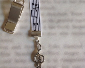 Music bookmark with clip - Attach clip to book cover then mark the page with the ribbon. Never lose your bookmark!