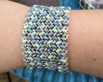 Green, blue and silver beaded bracelet