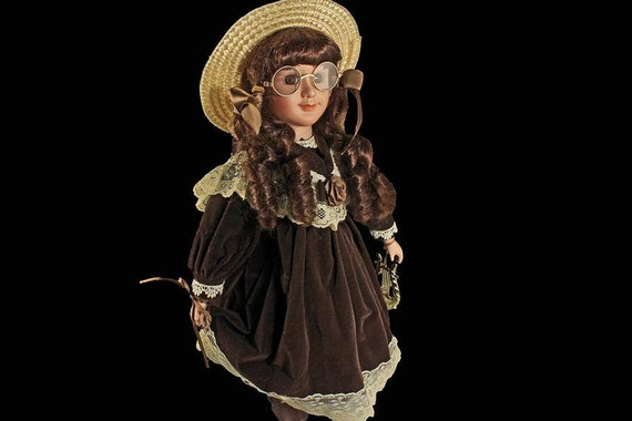 Collectible Porcelain Doll, Doll With Round Gold Rim Glasses, Straw Hat, Brown Velvet Dress, Display Doll, Stand Included, 17 Inch Doll