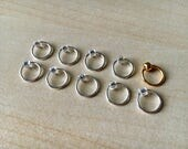 Set of 10 stitch markers in Golden Ticket