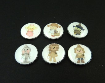 """6 Wizard of Oz Buttons. Washer and Dryer Safe.   Dorothy, Tin Man, Cowardly Lion, Scarecrow, Wicked Witch, Good Witch 3/4"""" or 20 mm."""