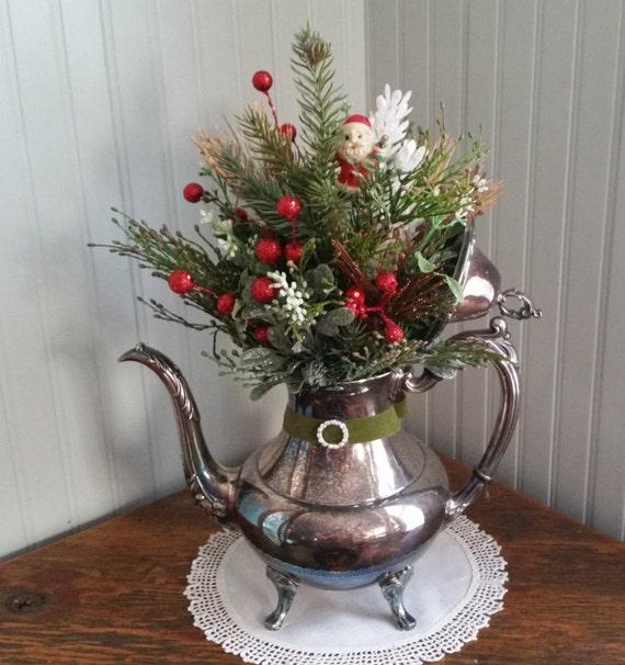 Christmas centerpiece arrangement in a vintage silver teapot