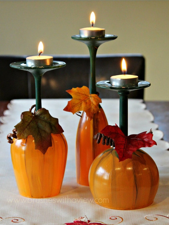 Fall table centerpiece pumpkin wine glasses thanksgiving