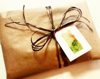 Gift wrapping, wrapping a gift, mothers day gift wrap, birthday gift wrapping, Christmas gift