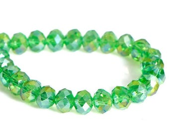 70 beads faceted glass green 8x6mm