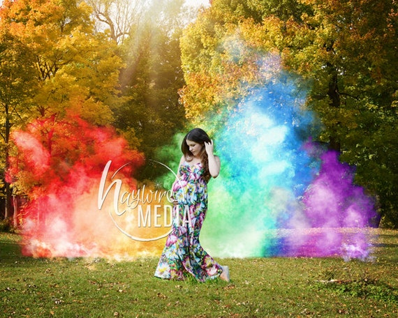 rainbow baby pregnancy photo scene in the park with colorful