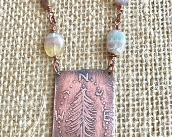 Etched copper points of the compass pine pendant with natural stone accent beads