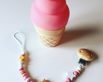 Attached nipple with white, beige and pink wooden beads