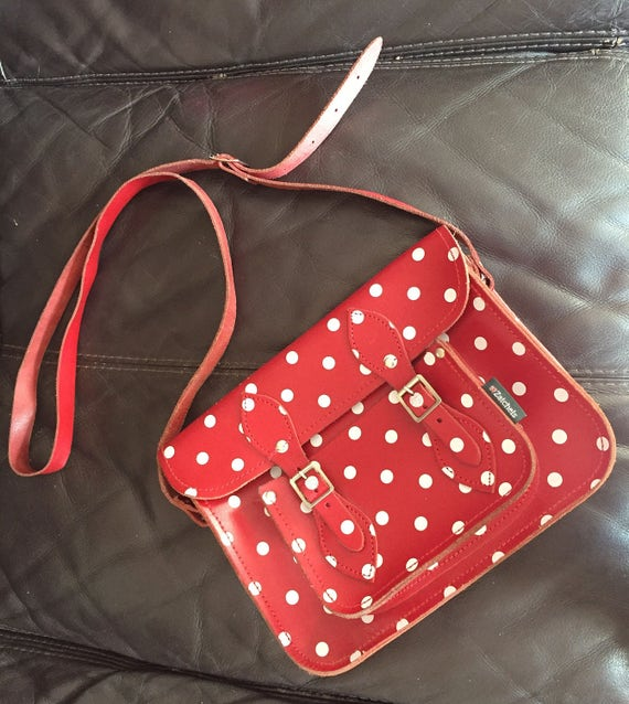 Red polka dot leather satchel