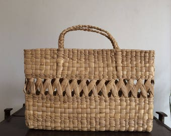 Natural fibers woven bag.