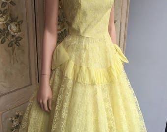 A fabulous lemon 1950s prom dress in satin and lace. Guide size 6-8. Divine!