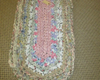 Croceted rag rug. Pink,tan, white and other pastels. JW8