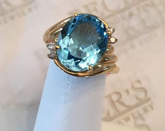 Vintage 14k yellow gold Oval 12x10mm Blue Topaz Ring, with 4 Diamonds at app. 5.30 tw, size 6.75
