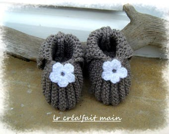 Baby booties baby girl knitted raw linen color.