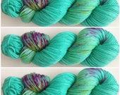 Loch Mermaid. Hand Dyed Yarn. DK wieght. Light worsted. Hand painted Speckled Yarn 100% Polwarth wool 100g.