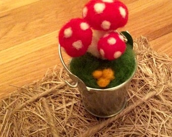Toadstools needle felted in a miniature silver coloured bucket. Made from Merino sheeps wools