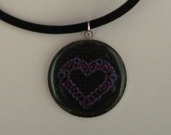 Necklace embroidered purple heart on black background
