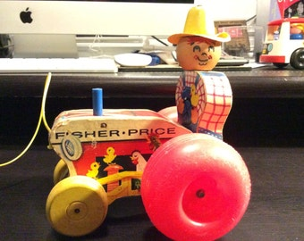 Fisher Price Pull Tractor & Farmer