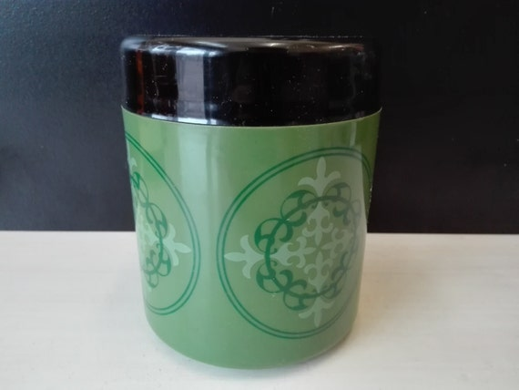 Green plastic storage canister