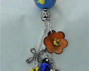 Tassel pendant - torch fired enamel bead with with 5 dangles - star, flower, lady bug, cross, charm