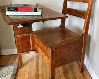 Antique late 19th century quartersawn oak student desk with tilting desktop and inkwell holder