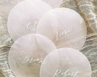 Elegant capiz shell place cards with romantic, modern calligraphy - natural, seashell beach