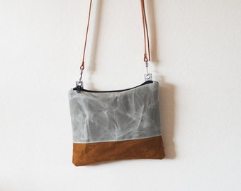 New waxed canvas crossbody bag with zipper and vegetable tanned leather strap