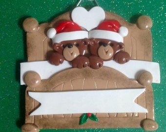 Two Bears in a bed with Santa hats polymer clay personalized ornaments!