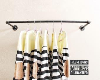 Industrial pipe clothing rack ⋆ Industrial hanger ⋆ retail display rack ⋆ pipe rack⋆closet rod ⋆ commercial display ⋆ pipe bar⋆ garment rack