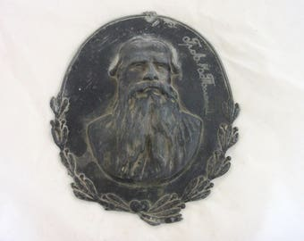 Antique pewter bullet of Leo Tolstoy (Lev Tolstoy) signed by owner.Russian antique pewter plaques of Lev Tolstoy