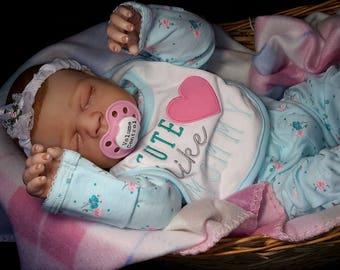 Biracial baby girl reborn doll.